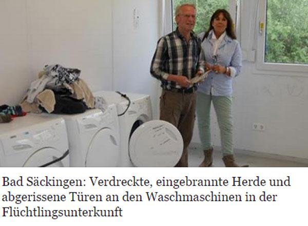 Bild zum Thema Ehrenamtliche Betreuer stehen vor den zerstörten ehemals nagelneuen Waschmaschinen in einer Migrantenunterkunft. Kein Kultur, keine Ehre, nichts für Deutschland. Und Tschüss.